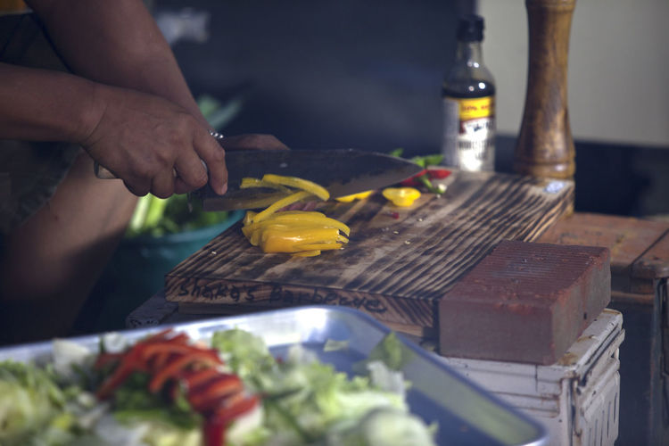 Barbeque Bell Pepper Chef Close-up Cooking Cooking Cool Cropped Culture Delicious Focus On Foreground Food Freshness Freshness Indulgence Knife Lifestyles Outdoors Part Of Preparation  Ready-to-eat Salad Selective Focus Unrecognizable Person Vegetable