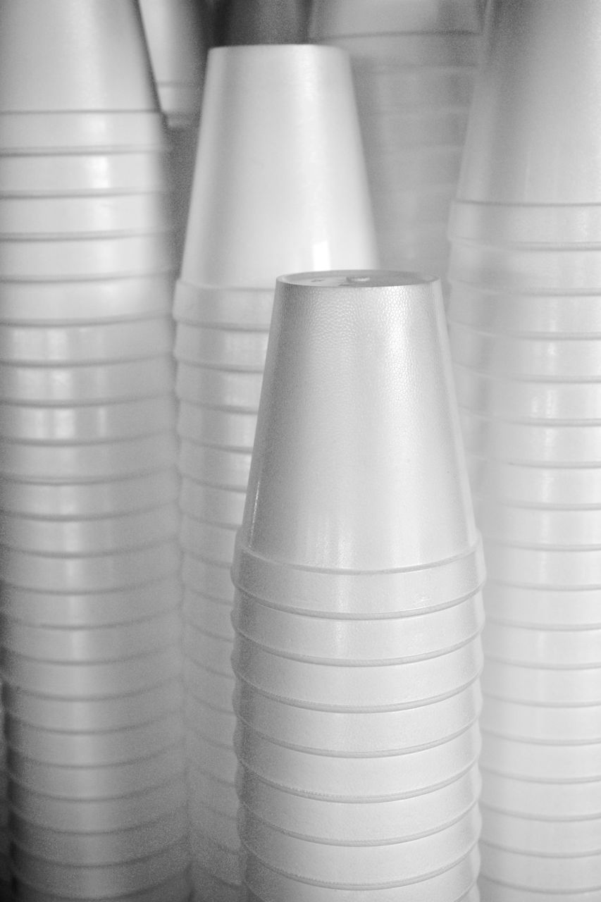close-up, no people, indoors, still life, white color, industry, arrangement, stack, metal, large group of objects, focus on foreground, food and drink, ceramics, business, shiny, disposable, full frame, pattern, order, in a row, silver colored, alloy, steel