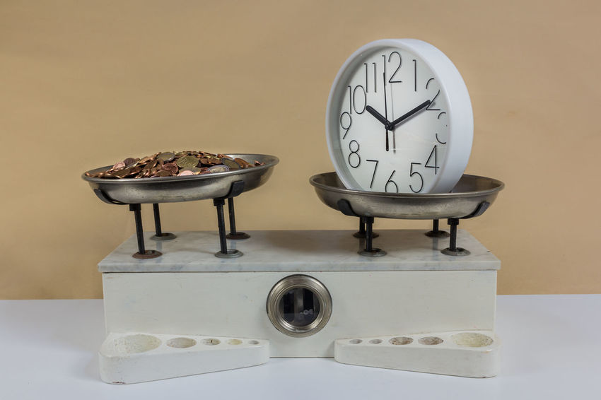 Balance with two metal plates with weights and clock Antique Balance Clock Diet Gram Imbalance Kilogram Measure, Measurement Metal Money Old Retro Time Vintage, Toy, Old Photo Weight