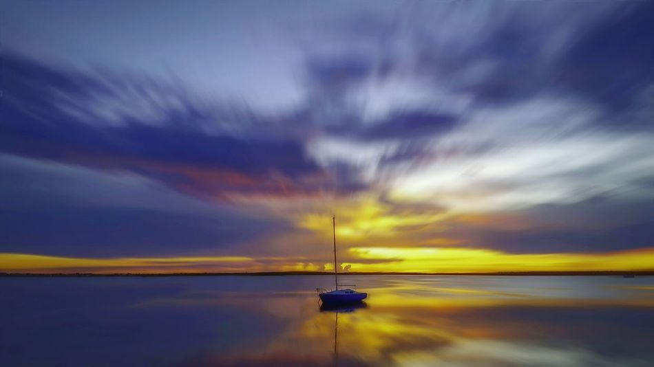Transportation Nautical Vessel Boat Water Mode Of Transport Calm Tranquil Scene Waterfront Ocean Sea Tranquility Scenics Cloud Sky Nature Majestic Non-urban Scene Beauty In Nature Seascape Outline Travel Destinations Cloud - Sky Tranquility Horizon Over Water Cloudscape