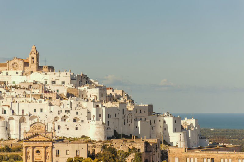 Panoramic view of the medieval white village of Ostuni Architecture Built Structure Building Exterior Building Sky City Nature Day Outdoors Panoramic Ostuni Panorama Panoramic Ostuni Ostuni Salento Puglia Seacoast Adriatic Sea White Village White Houses White Buildings Cathedral Church Brindisi Valle D'itria Salento Blue Sky