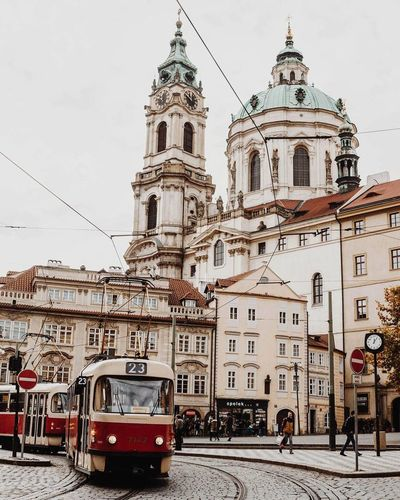Religion Travel Destinations Architecture Outdoors Travel Day Cloud - Sky Place Of Worship Sky City Building Exterior Clock Tower Built Structure People Cityscape Adult Tram Praga Prague Prague Czech Republic Streetphoto VSCO