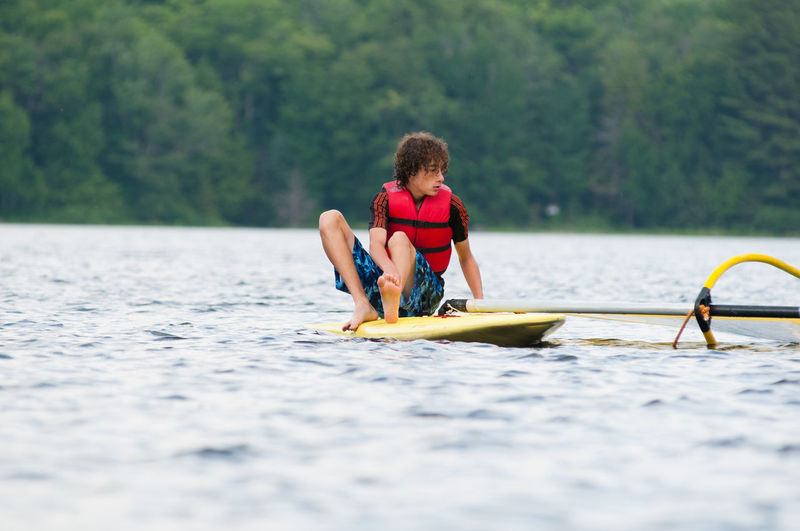 Ontario, Canada Recreation  Summertime Wind Surfing Wind Surfer Adventure Boy Day Lake Leisure Activity Lifestyles Nature People Real People Recreational Pursuit Summer Teen Water Waterfront