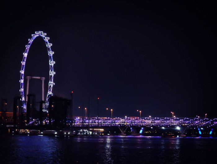 [ Singapore Flyer + Helix Bridge ] City Lights City View  City At Night Street Lights EyeEm Best Shots Bridge Ferris Wheel Q Quality Cities At Night Tourist Attraction  Tourist Destination Tourist Tourism Travel Destinations Travel Traveling Welcome To Black Singapore Neighborhood Map Capture Tomorrow