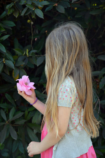 Rear view of a girl with pink flower