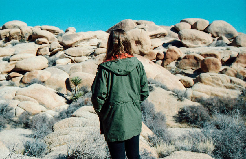 my sister amongst the rocks Adventure California Casual Clothing Color Portrait Day Desert Ektar100 EyeEm Nature Lover Film Film Photography Getting Away From It All Girl Green Joshua Tree Nature Physical Geography Portrait Real People Rock Rocks Sand Standing Three Quarter Length Young Adult Young Women