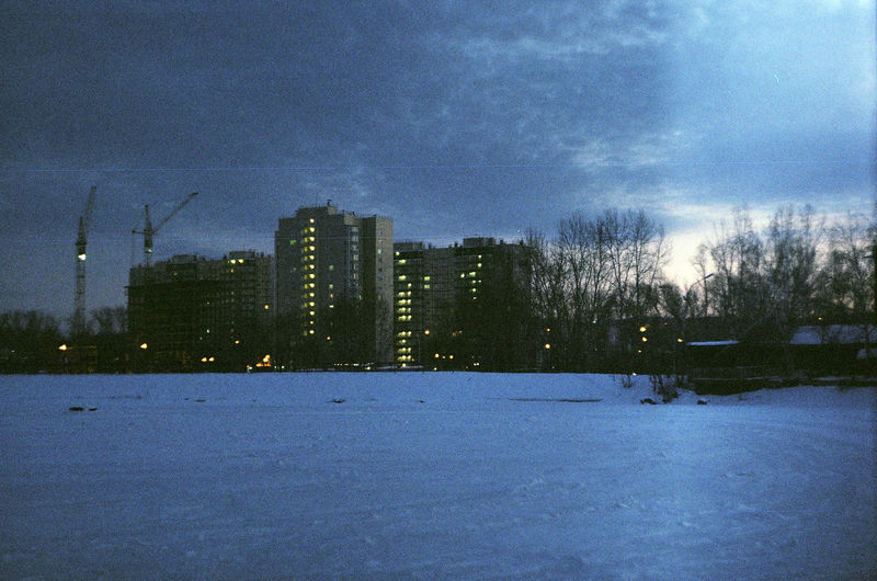 Scenic view of city against sky during winter