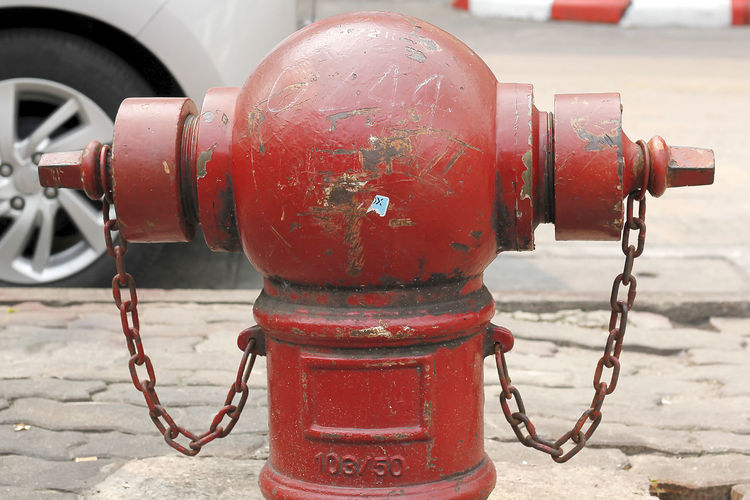 Close-up of fire hydrant on street in city