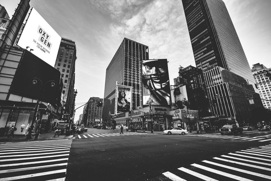 B&W NYC morning view Blackandwhite NYC NY Architecture Built Structure City Sky Building Exterior Nature Day Office Building Exterior Building Street Cloud - Sky Tall - High Transportation Road Road Marking Outdoors Crosswalk
