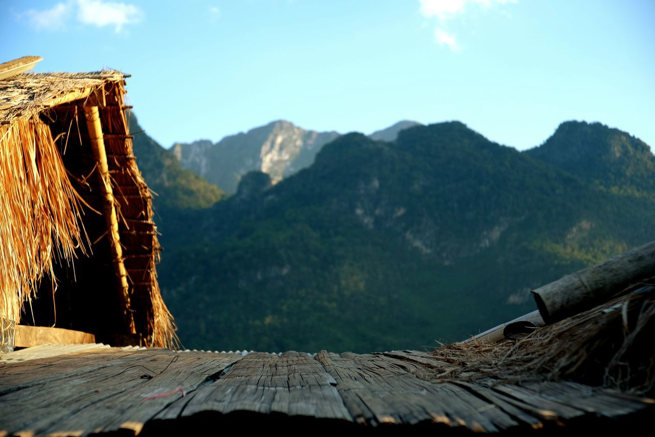 mountain, wood - material, nature, sunlight, outdoors, day, no people, mountain range, beauty in nature, sky, scenics, close-up