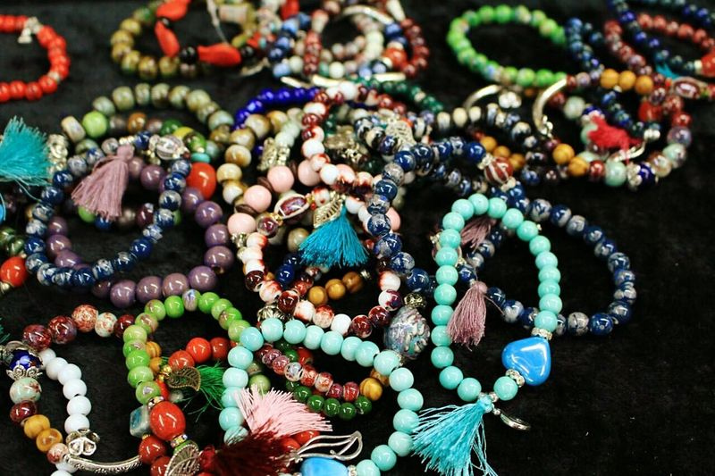 High angle view of colorful beaded bracelets at store