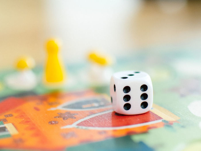 Close-Up Of Dice On Board Game
