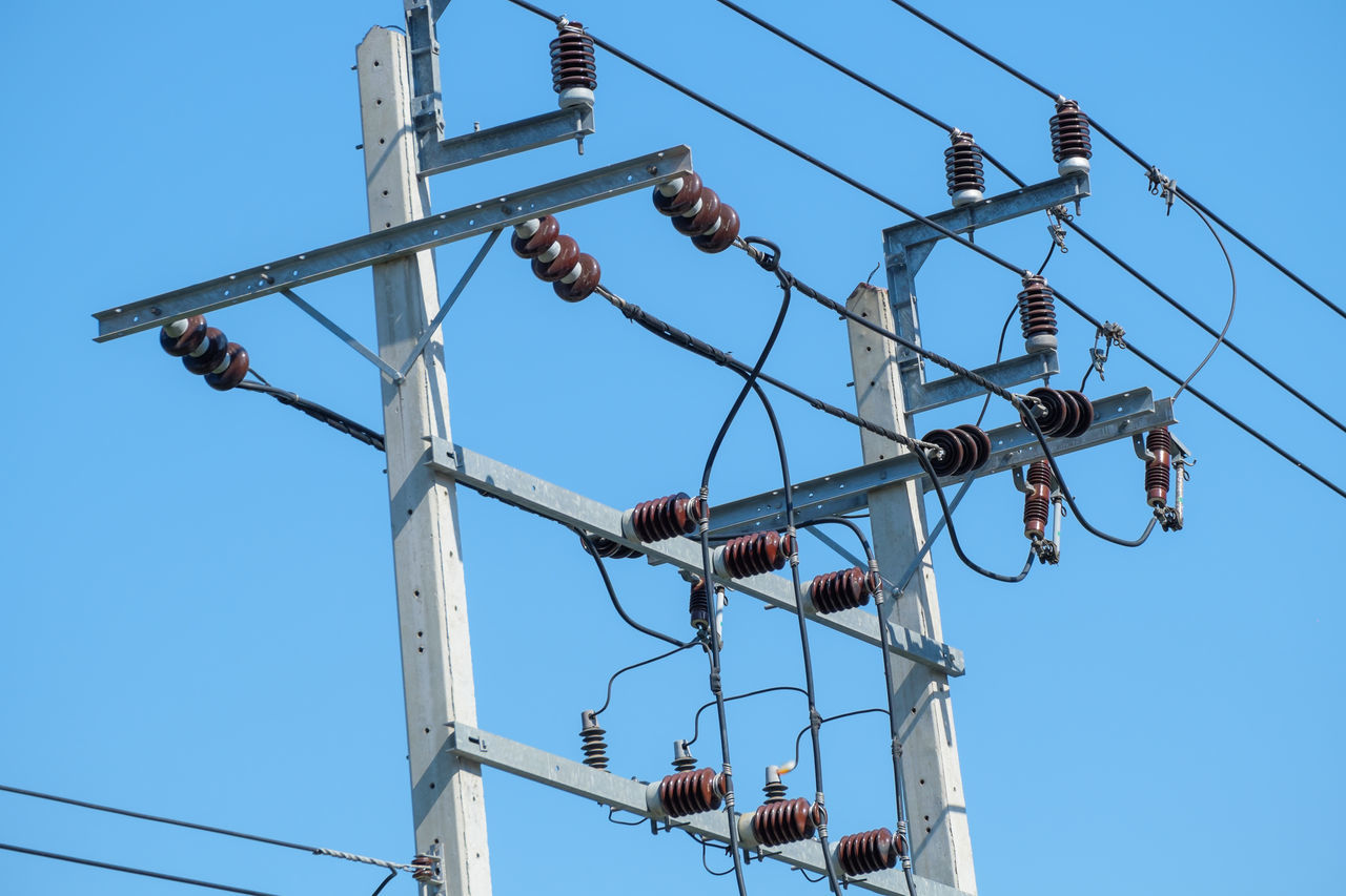 Low Angle View Of Electricity Transformer Against Clear Blue Sky