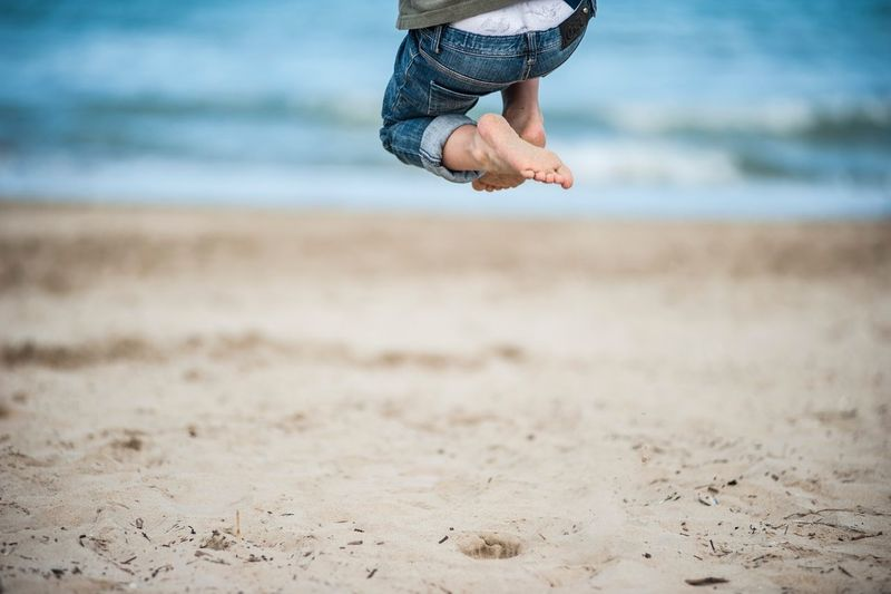 Jump Foot Feets Italy Land Beach Low Section One Person Sand Human Body Part This Is Strength Human Leg Focus On Foreground Water Real People Jumping Outdoors Body Part Sea Mid-air A New Perspective On Life