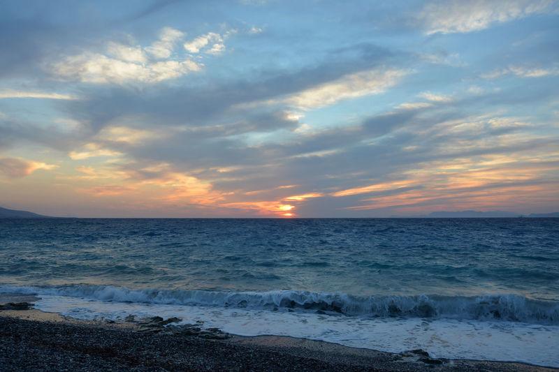 Beach Beauty In Nature Cloud - Sky Horizon Horizon Over Water Idyllic Motion Nature Outdoors Scenics - Nature Sea Sky Sunset Water Wave