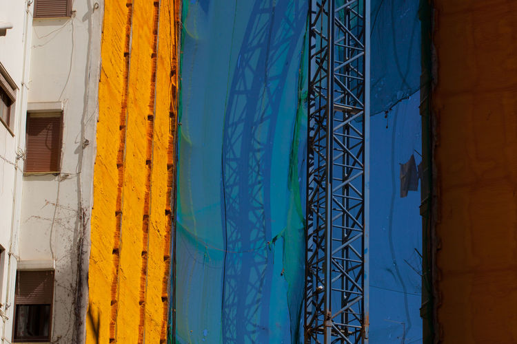 City Colourful Corrosion Reflection Renovation Architecture Blue Building Exterior Built Structure Crane Demolition Multi Colored Yellow The Week On EyeEm Paint The Town Yellow The Graphic City The Architect - 2018 EyeEm Awards