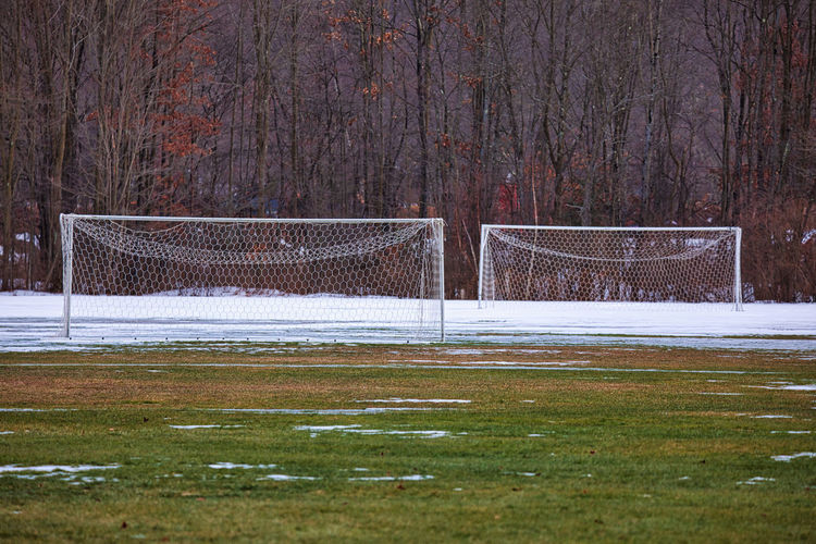Empty benches on field during winter
