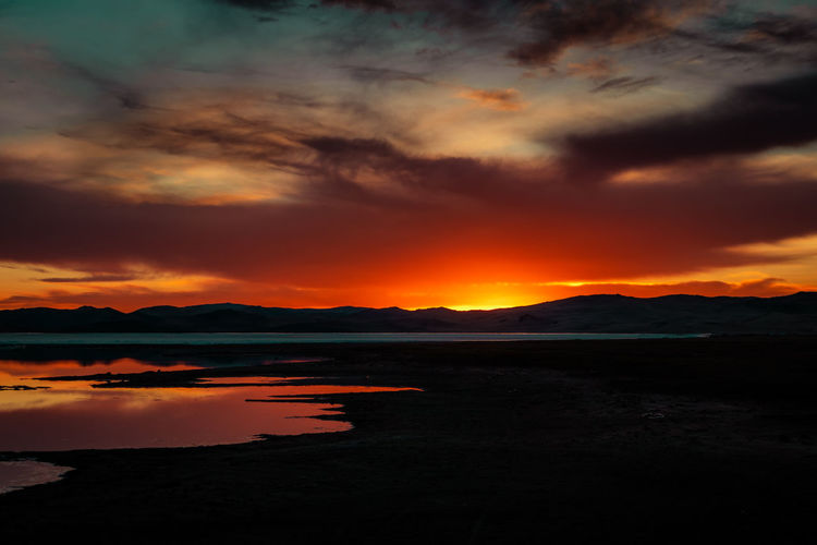 Mongolia Sunset Sky Cloud - Sky Orange Color Beauty In Nature Tranquil Scene Scenics - Nature Tranquility Water Silhouette Idyllic Nature Lake No People Non-urban Scene Dramatic Sky Mountain Environment Reflection Outdoors Romantic Sky The Traveler - 2019 EyeEm Awards