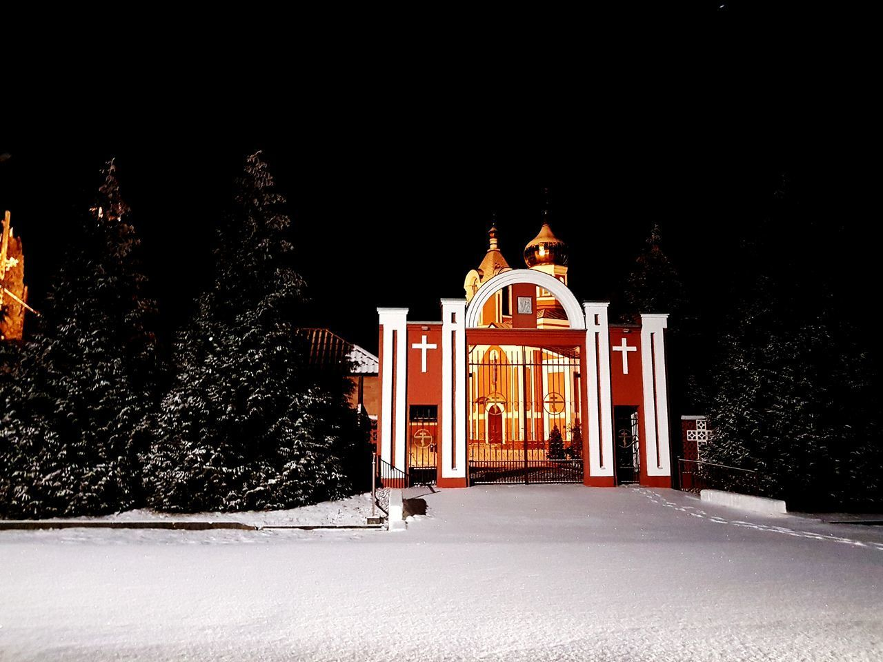 snow, cold temperature, winter, architecture, night, built structure, religion, illuminated, place of worship, belief, building, nature, building exterior, tree, spirituality, no people, covering, sky