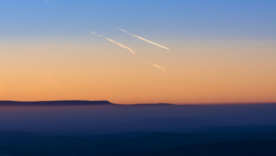 Vivid sunset Malvern Hills Sunset_collection Air Vehicle Airplane Beauty In Nature Cloud - Sky Flying Mode Of Transportation Mountain Mountain Range Nature No People Orange Color Outdoors Scenics - Nature Silhouette Sky Sunset Tranquil Scene Tranquility Transportation Vapor Trail