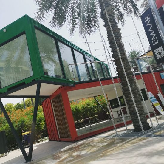 Container Coffeeshop Red Green Tree City Sky Architecture Building Exterior Built Structure