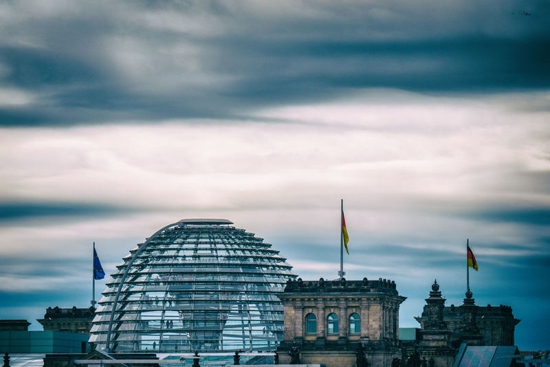 People walking in the reichstag dome in berlin with dense clouds