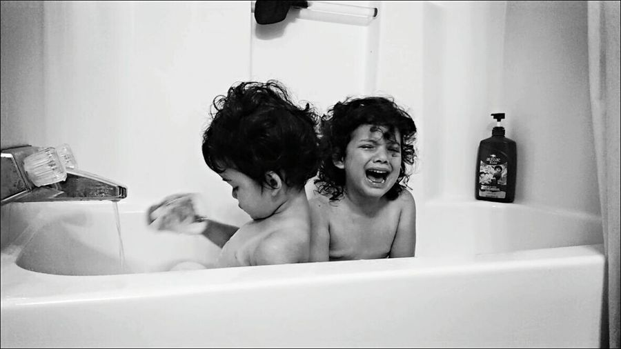 I love how different my girls react over a situation! Obviously one is more expressive about her discontent over how much bubbles are in the bathtub and one just simply moves on with the flow haha. Bnw_friday_eyeemchallenge Mad Emotions Eye4photography  Dramatic Vs Calm The Human Condition Fortheloveofblackandwhite OpenEdit Eyem Black And White Popular Photos