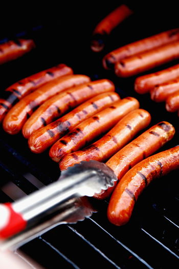 Close-up of hot dogs on barbecue grill