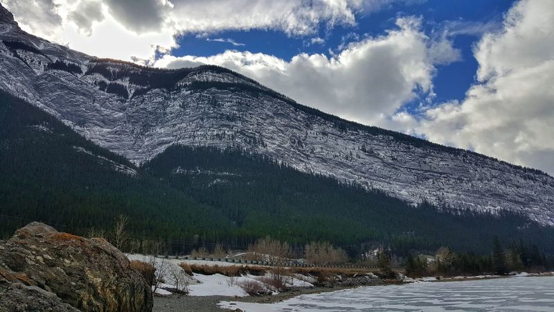 Landscape Mountain Nature Beauty In Nature Mountain Range Cloud - Sky Scenics Sky No People Tree Tranquility Snow Outdoors Water Day Beauty In Nature Winter Nature Ice Cold Temperature Canmore Alberta Canada Getty Images