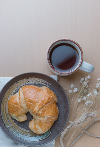 Black Coffee Breakfast Close-up Coffee - Drink Coffee Cup Croissant Day Food Food And Drink Freshness Indoors  Indulgence No People Plate Ready-to-eat Sweet Food Table