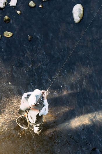 High angle view of man fishing by sea