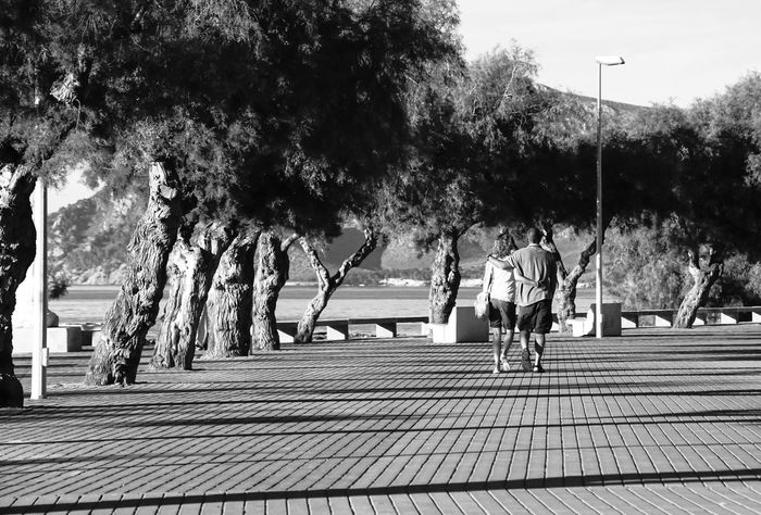 at waterfront Colònia de Sant Pere Mallorca Arm In Arm B&w Black And White City Life Holiday Leisure Activity Lifestyles Love Mallorca Promenade Sky SPAIN Spanien Spanish Street Photography Streetphoto_bw The Way Forward Tree Urlaub Waterfront