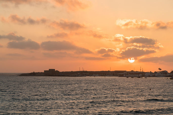 Setting sun liting clouds and the harbour of Paphos City, Cyprus City Cityscape Day No People Outdoors Sea Sky Sunset Travel Destinations Urban Skyline Water
