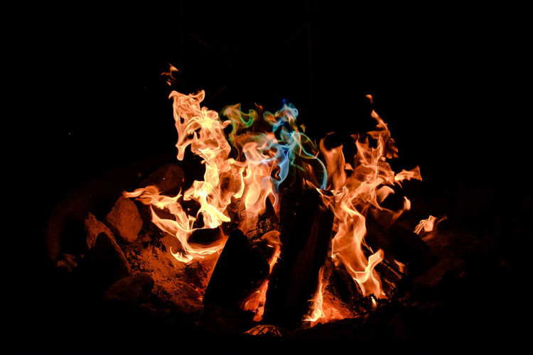 BURNING BONFIRE WITH COPY SPACE ON BLACK BACKGROUND