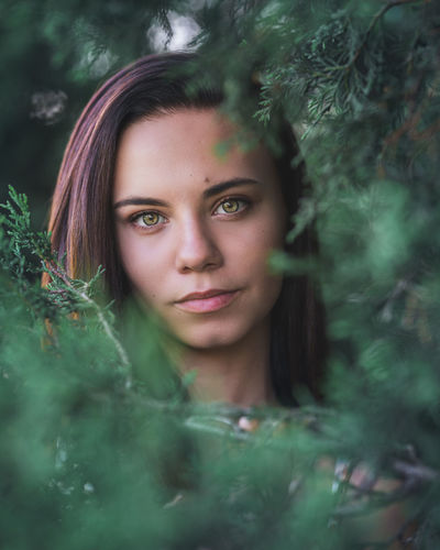In the Trees Portrait Young Adult One Person Young Women Plant Headshot Looking At Camera Front View Real People Beautiful Woman Leisure Activity Women Tree Selective Focus Green Color Lifestyles Beauty Nature Hair Outdoors Hairstyle Contemplation Teenager