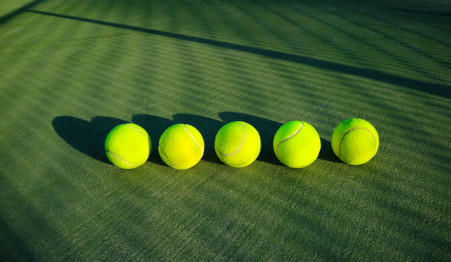 Tennis ball minimalism background Background Ball Close-up Four Objects Green Color Group Of Objects High Angle View In A Row Indoors  Medium Group Of Objects Minimal Minimalism Multi Colored Nature No People Shadow Side By Side Sport Sports Photography Still Life Tennis Tennis Ball Yellow