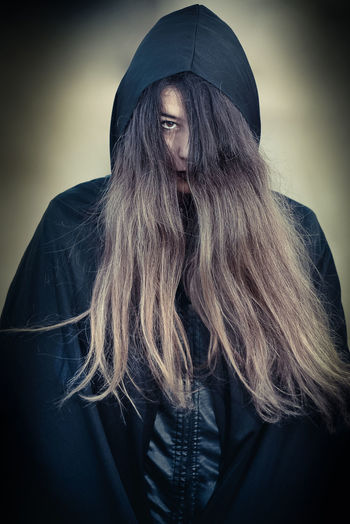 Adult Adults Only Beard Beautiful Woman Beauty Cape  Close-up Dark Day Fashion Human Body Part Indoors  Long Hair One Person One Woman Only One Young Woman Only Only Women People Portrait Studio Shot Witch Young Adult Young Women