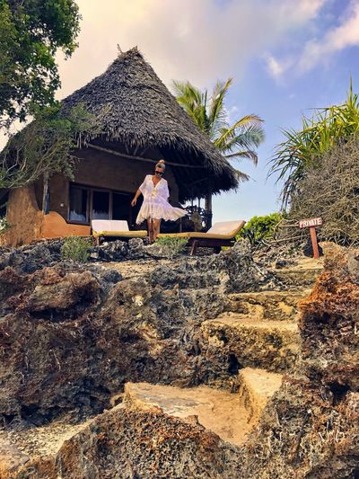Young Adult Thatched Roof Travel Hut Village Sky Women Lifestyles Candid Vacations Summer Travel Destinations Walking Around Scenics Tranquility Evening Africa Resort Beachvilla Destination Happiness Nature Leisure Activity