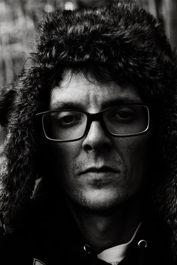 Close-Up Portrait Of Man Wearing Glasses