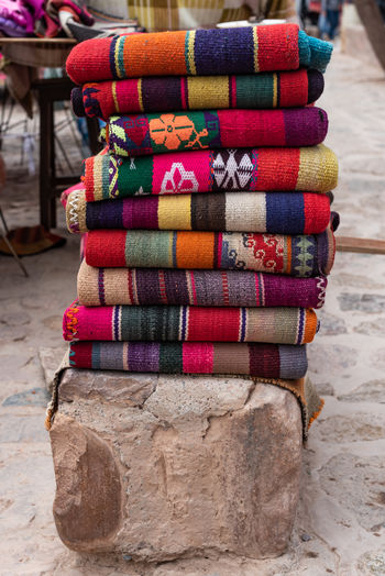 Stack of multi colored blanket at market stall