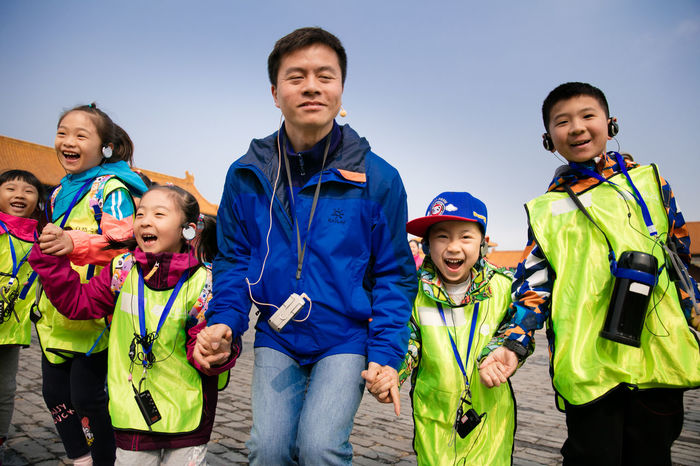 Connected By Travel Blue Boys Childhood Clear Sky Day Friendship Happiness Leisure Activity Lifestyles Nature Outdoors People Portrait Real People Sky Smiling Sport Standing Togetherness Tree Warm Clothing Young Adult Young Women