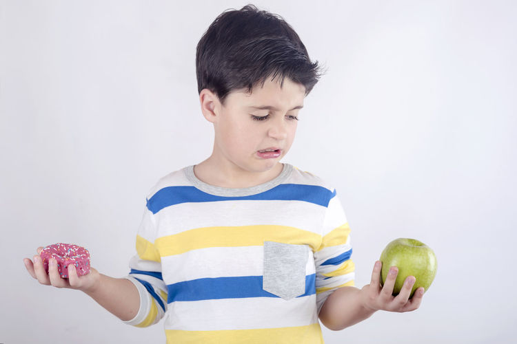 Angry Bad Nutrition Eating Fast Food Indifferent Lunch Snack Sugar Unhappy Appetite Apple - Fruit Bored Boredom Calories Childhood Fat Food Freshness Fruit Hate Healthy Eating Nutrients White Background