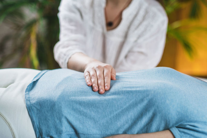 Midsection of woman getting massage at spa
