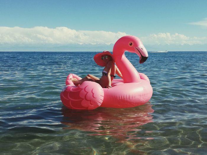 Stuffed toy on sea against sky