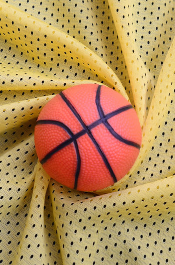 Directly above shot of basketball on patterned fabric