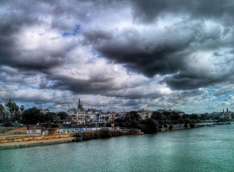 Rio Guadalquivir Sevilla SPAIN Riverside Urban Landscape Cloudy Clouds Rainy Day Stormy Weather