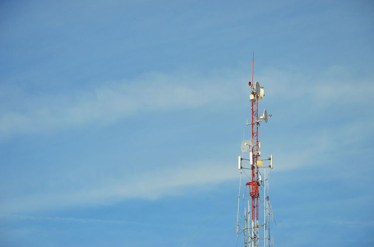 radio pole (telecommunication antenna) on blue sky and soft clouds background Antenna Blue Cellphone Cellphone Tower Cloud Cloud - Sky Day Development No People Outdoors Pole Radio Tower Sky Tall - High Telecommunication Tower Telephone