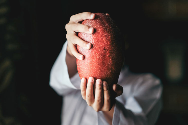 Man holding fruit