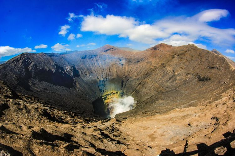 a small active crater INDONESIA Bromo Folk EyeEmNewHere Landscapes Mountain View Crater EyeEm Selects Mountain Erupting Power In Nature Sand Volcanic Crater Volcanic Landscape Blue Volcano Sky Landscape Geyser Sulphur Heat Geology Smoke Java Gas Volcanic Activity Active Volcano Steam