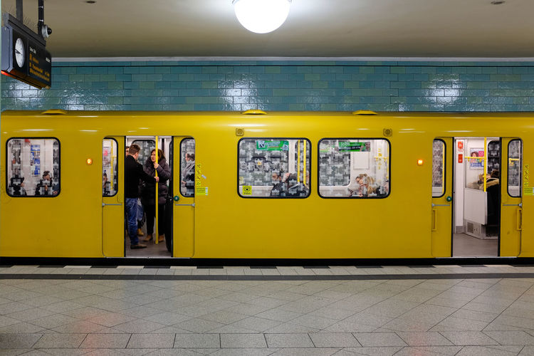 Yellow metro train carriage on a platform with doors open Metro Night Train Open Doors  Carriage Day Doors Opening Getting Around Illuminated Indoors  No People Platform Public Transport Public Transportation Train Yellow